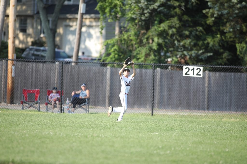 Centerfielder Charlie Levy makes the catch early in the game.
