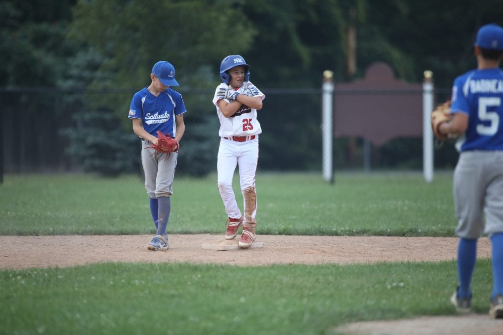 Paul Donaghue celebrates after hitting a double.