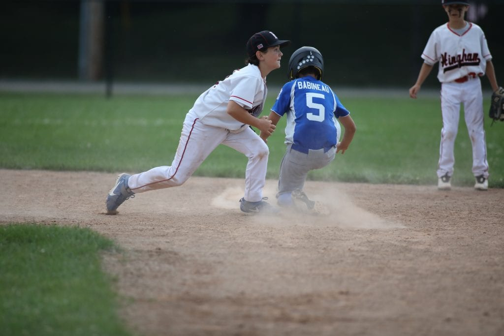 Cole Snowden with the tag on the runner.