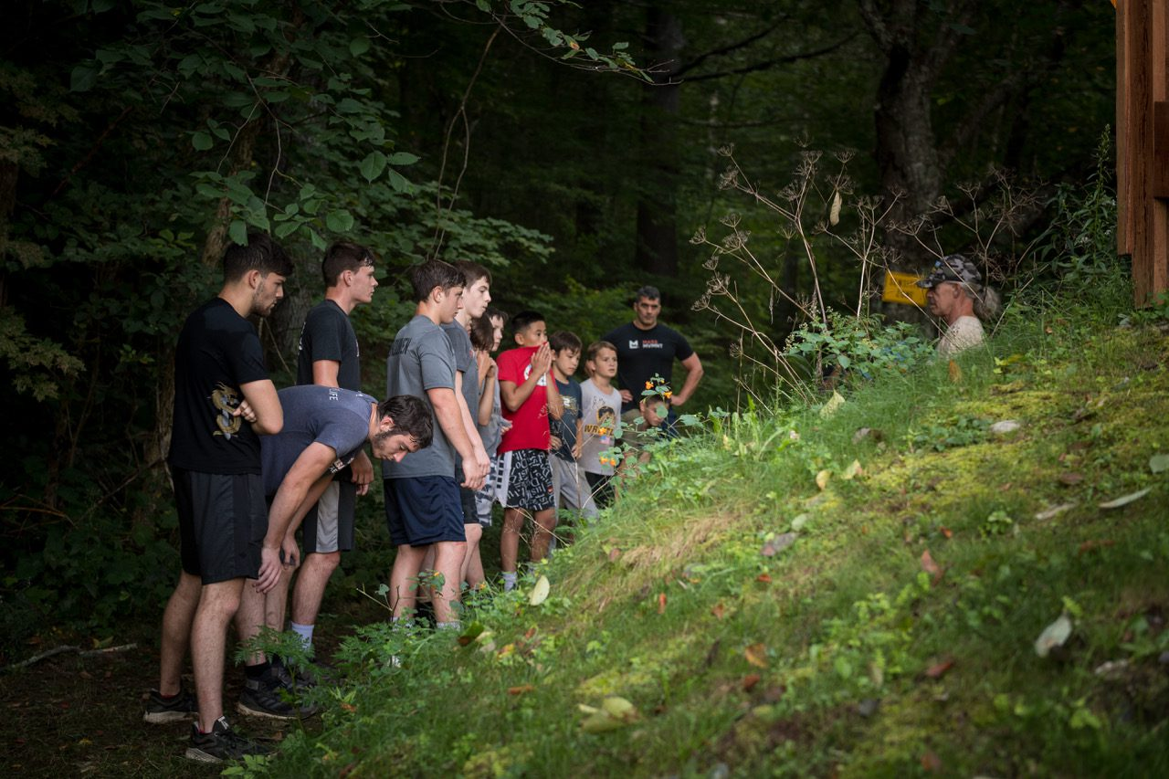 Wrestlers line up as they finish a mountain workout with their coaches at Camp Spartan in Pittsfield, VT.