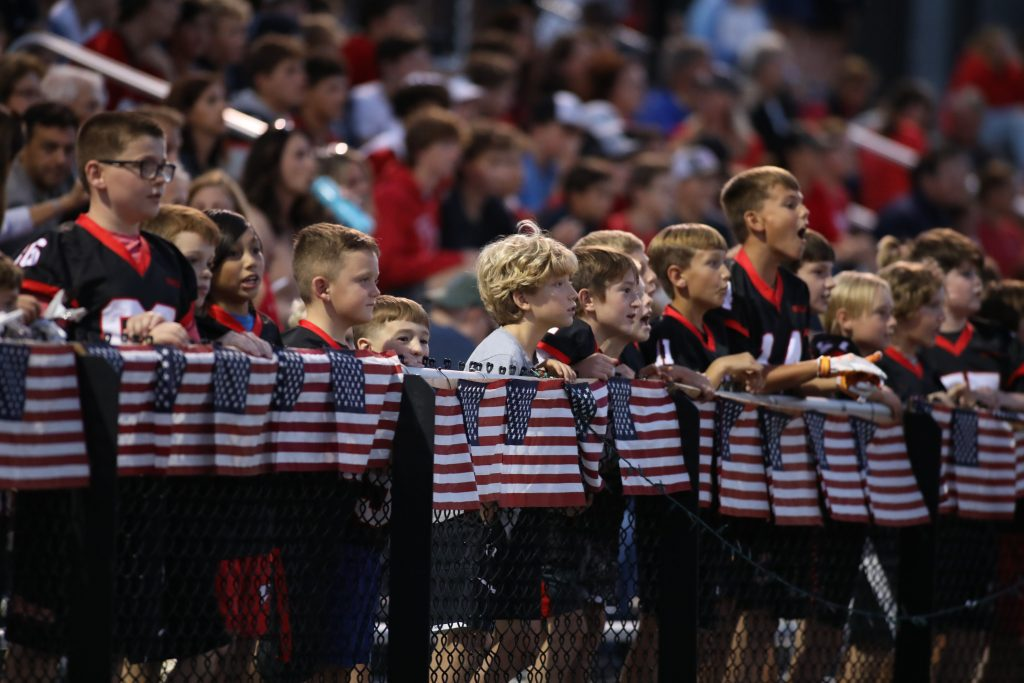 The stands were packed with Hingham Youth Football players cheering on the high school team.