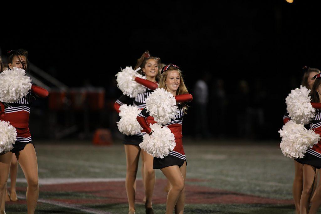 Hingham High School Dance team performs at halftime.