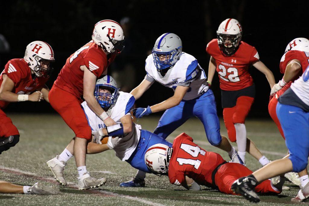 Junior Brendan Hill makes the tackles.