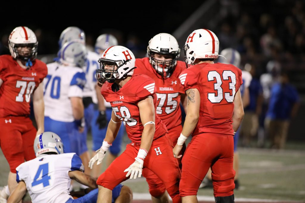 Senior Henry Drinkwater celebrates his sack in the second half.