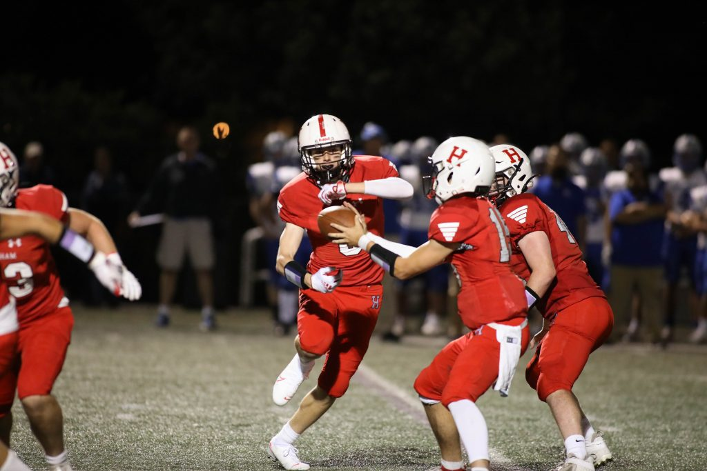 Senior Nick O'Connor with the handoff late in the game.