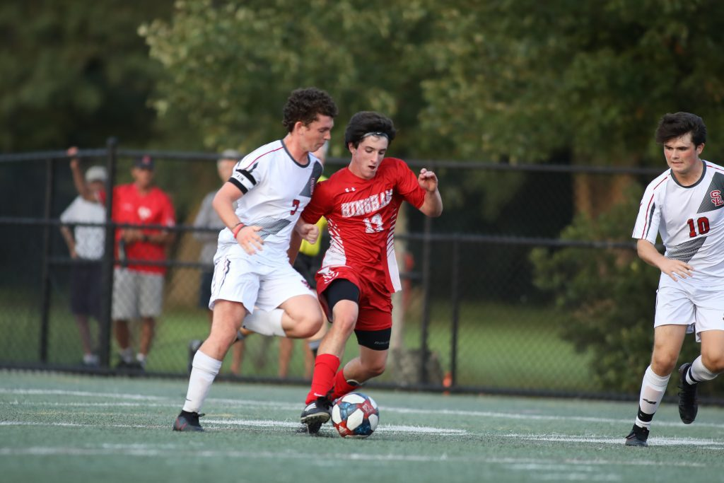 Senior Thomas Healey fights for possesion in the Silver Lake end.