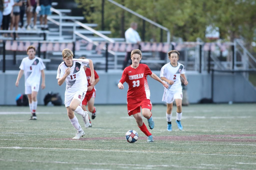 Senior Matthew Carr looking to push the Hingham lead late in the first half.
