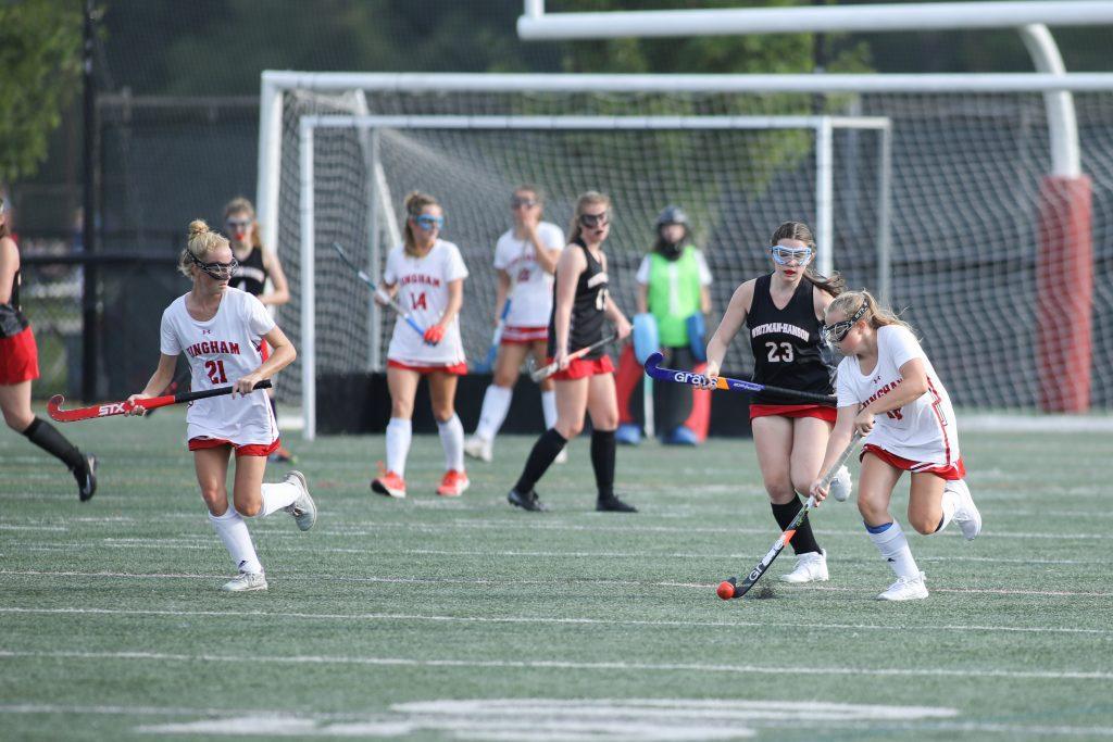 Freshman Haylen Wilson (18) moves the ball up the field with her sister, senior captain Kenzie Wilson