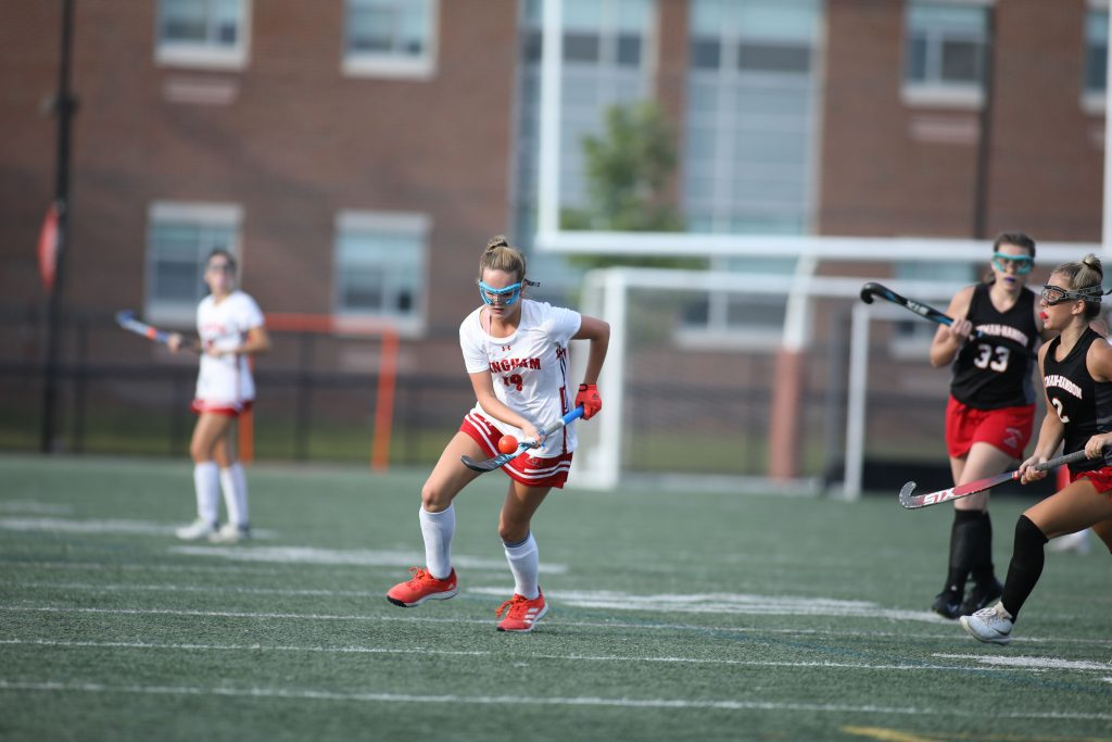 Freshman Sienna Brackett skillfully bounces the ball on her stick as she moves up field.