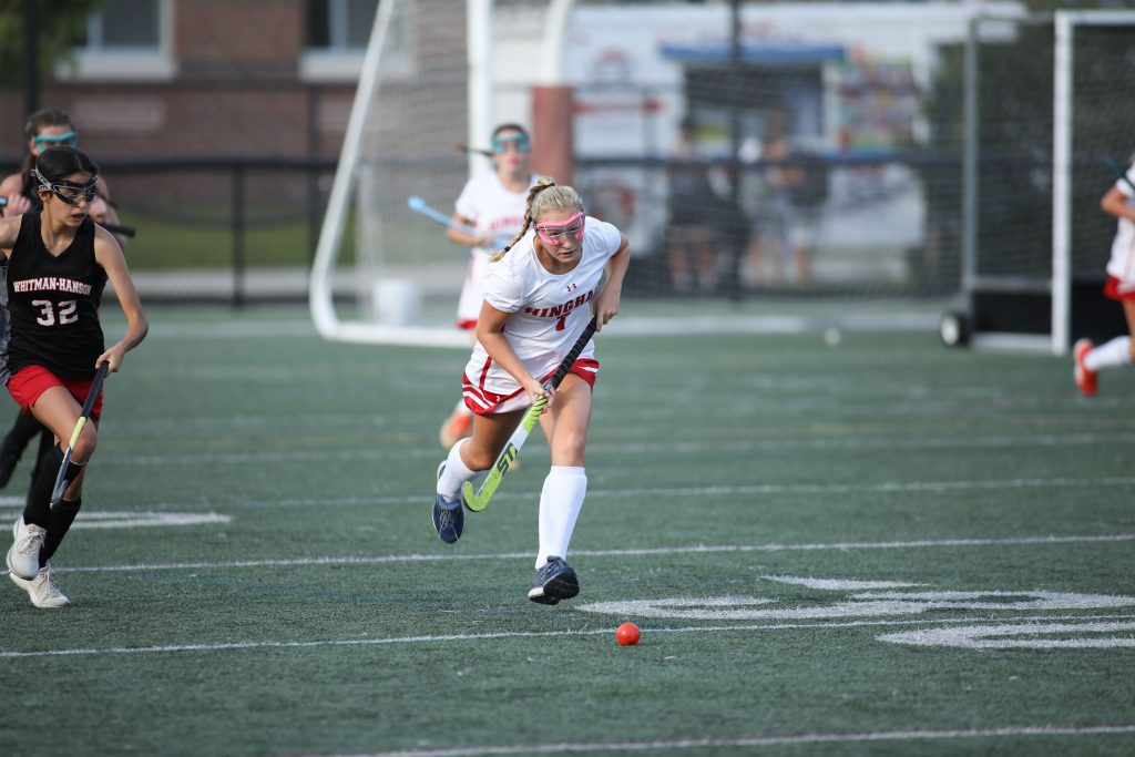 Junior Morgan Beighley chases after a loose ball.