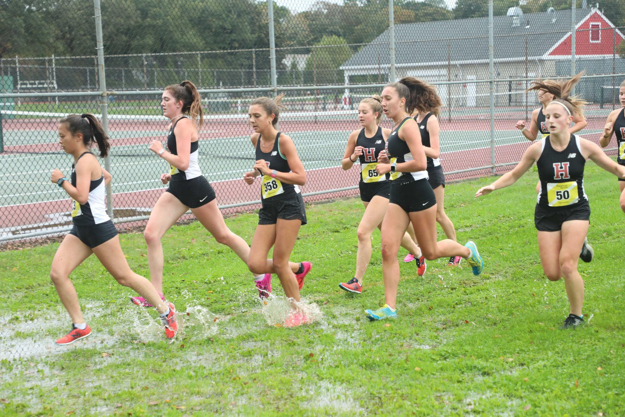 On a mostly dry course, the boys and girls teams win their meets to stay perfect on the season.
