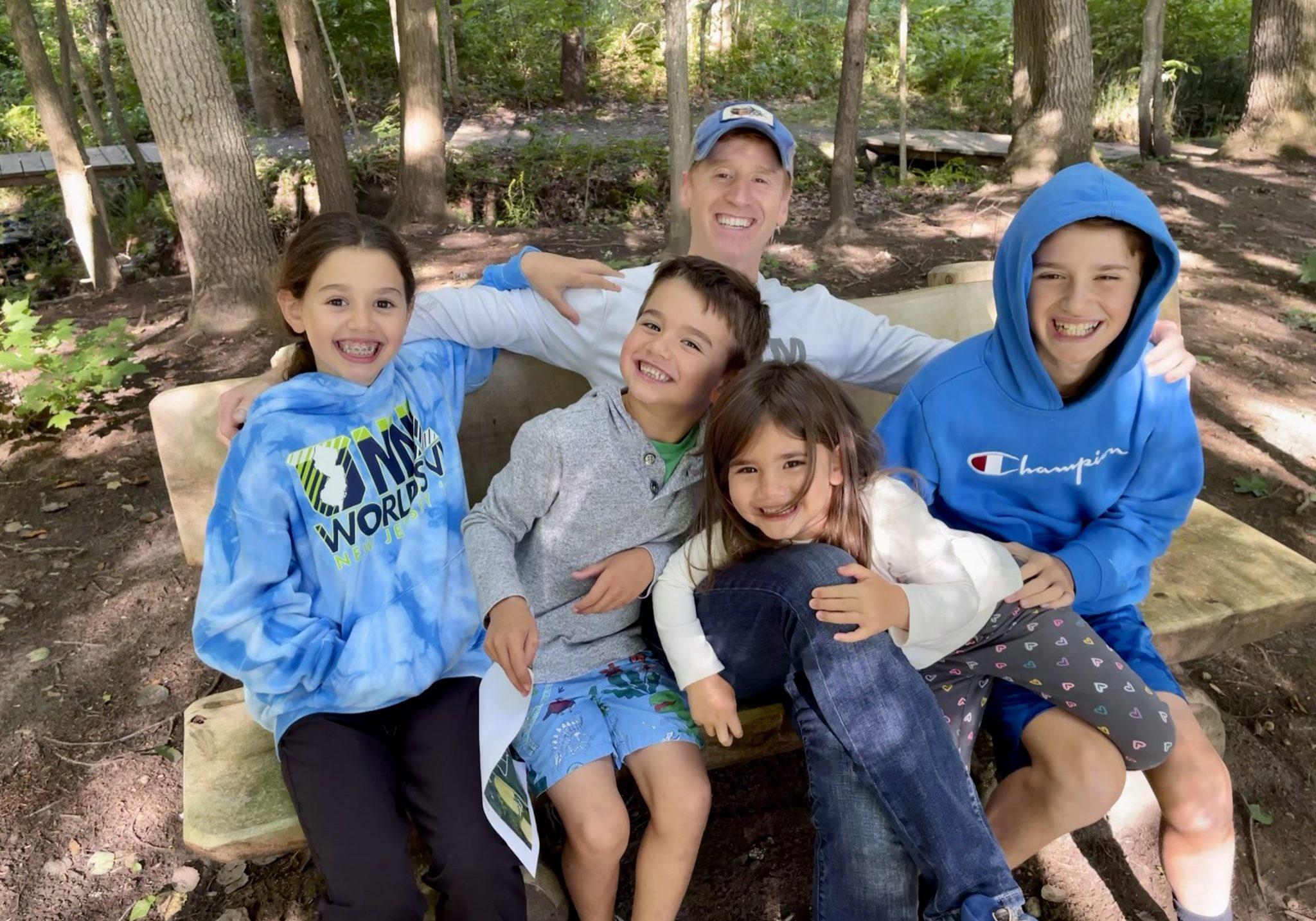 John with children Vivienne, Teddy 6, Rosie 4, Jack 12