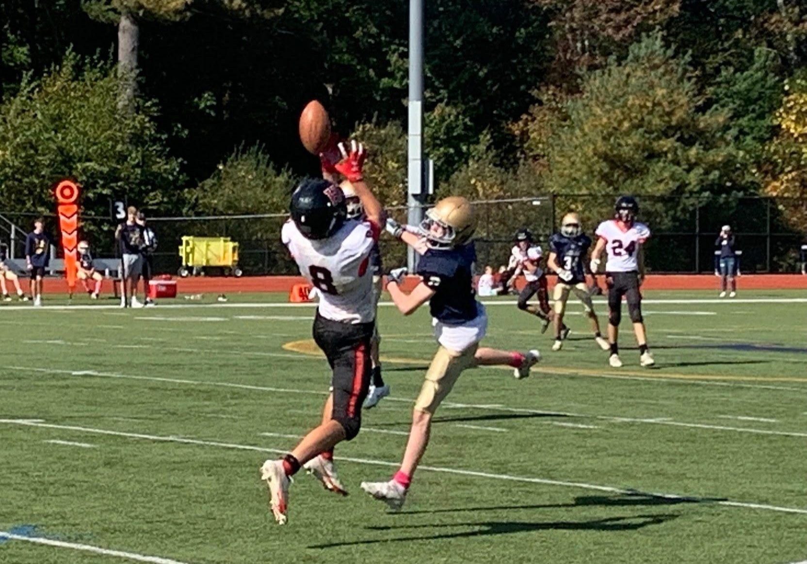 #8 JT Reale makes an acrobatic catch for a big gain.